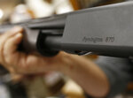 FILE - In this March 1, 2018 file photo, the Remington name is seen etched on a model 870 shotgun at Duke's Sport Shop in New Castle, Pa. For years, the gun industry has been immune from most lawsuits, but a recent ruling allowing families of victims in the Newton school shooting to challenge the way an AR-15 used by the shooter was marketed is upending that longstanding roadblock. The U.S. Supreme Court recently rejected efforts by gunmaker Remington to quash the lawsuit, allowing it to continue to be heard in Connecticut courts. (AP Photo/Keith Srakocic, File)