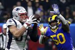 New England Patriots' Rob Gronkowski (87) catches a pass in front of Los Angeles Rams' Cory Littleton (58) during the second half of the NFL Super Bowl 53 football game Sunday, Feb. 3, 2019, in Atlanta.(AP Photo/Patrick Semansky)