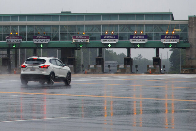 A motorist passes through a New Jersey Turnpike toll plaza, Friday, July 31, 2020, in Carneys Point, N.J. (AP Photo/Matt Slocum)