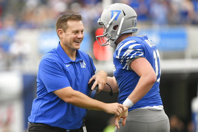 Memphis head coach Ryan Silverfield, left, celebrates a field goal by Joe Doyle, right, during the second half of an NCAA college football game against Mississippi State, Saturday, Sept. 18, 2021, in Memphis, Tenn. (AP Photo/John Amis)
