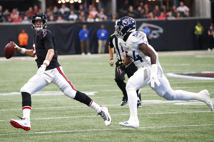 Atlanta Falcons quarterback Matt Ryan (2) works against Tennessee Titans inside linebacker Rashaan Evans (54) during the first half of an NFL football game, Sunday, Sept. 29, 2019, in Atlanta. (AP Photo/John Bazemore)