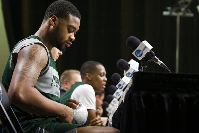 Michigan State forward Nick Ward adjusts an ice pack on his hand during an NCAA men's college basketball news conference in Washington, Saturday, March 30, 2019. Michigan State plays Duke in the East Regional final game on Sunday. (AP Photo/Alex Brandon)