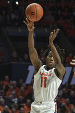 Illinois' Ayo Dosunmu (11) passes the ball against Iowa in the first half of an NCAA college basketball game Sunday, March 8, 2020, in Champaign, Ill. (AP Photo/Holly Hart)