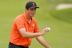 Amateur player, Viktor Hovland, of Norway, waves after his birdie putt on the sixth hole during the final round of the U.S. Open Championship golf tournament Sunday, June 16, 2019, in Pebble Beach, Calif. (AP Photo/David J. Phillip)