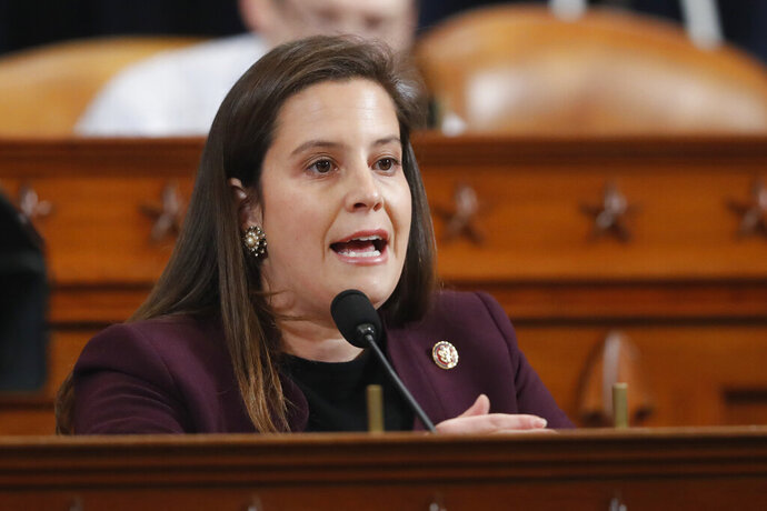 FILE - In this Nov. 21, 2019 file photo, Rep. Elise Stefanik, R-N.Y., asks questions during a public impeachment hearing in Washington regarding President Donald Trump's efforts to tie U.S. aid for Ukraine to investigations of his political opponents. Stefanik has been removed from a panel at Harvard University for making comments that perpetuated Trump's baseless claims of widespread voter fraud, the school announced Tuesday, Jan. 12, 2021. (AP Photo/Andrew Harnik, File)