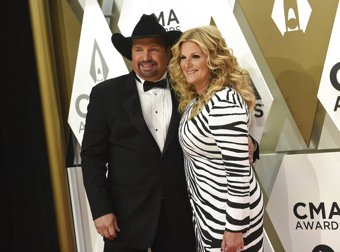 Garth Brooks, left, and Trisha Yearwood arrive at the 53rd annual CMA Awards at Bridgestone Arena on Wednesday, Nov. 13, 2019, in Nashville, Tenn. (Photo by Evan Agostini/Invision/AP)