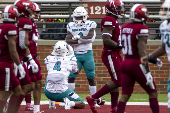 Coastal Carolina tight end Isaiah Likely (4) celebrates a touchdown with Coastal Carolina running back CJ Marable (1) against Troy during an NCAA college football game, Saturday, Dec. 12, 2020, in Troy, Ala. (AP Photo/Vasha Hunt)