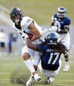 Wake Forest wide receiver Sage Surratt, left, breaks a tackle-attempt by Rice linebacker Treshawn Chamberlain (17) during the first half of an NCAA college football game Friday, Sept. 6, 2019, in Houston. (AP Photo/Michael Wyke)