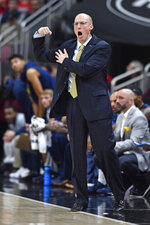 Akron head coach John Groce signals a play to his team during the first half of an NCAA college basketball game in Louisville, Ky., Sunday, Nov. 24, 2019. (AP Photo/Timothy D. Easley)