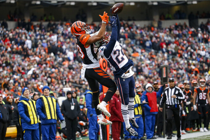 New England Patriots cornerback Stephon Gilmore (24) breaks up a pass to Cincinnati Bengals wide receiver Tyler Boyd (83) in the second half of an NFL football game, Sunday, Dec. 15, 2019, in Cincinnati. (AP Photo/Frank Victores)