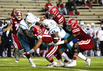 Louisiana-Lafayette running back Elijah Mitchell (15) is tackled by Coastal Carolina linebacker Enock Makonzo (43) and safety Cameron Mitchell (49) during the first half of an NCAA football game in Lafayette, La., Wednesday, Oct. 14, 2020. (AP Photo/Paul Kieu)