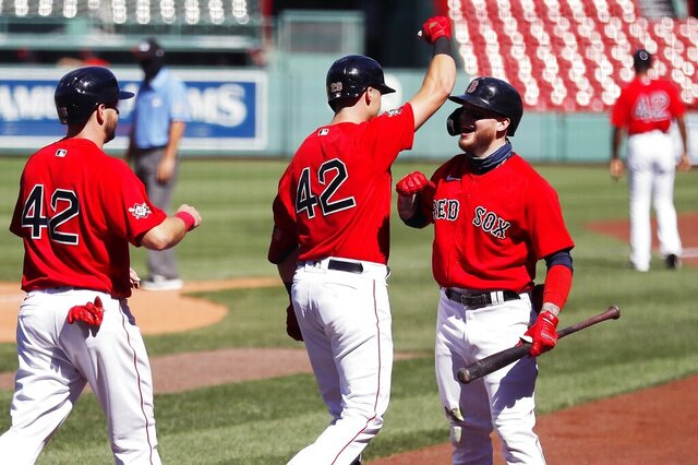 Boston Red Sox's Bobby Dalbec, center, celebrates his two-run home run with Alex Verdugo, right, that also drove in Kevin Plawecki, left, during the third inning of a baseball game against the Washington Nationals, Sunday, Aug. 30, 2020, in Boston. (AP Photo/Michael Dwyer)
