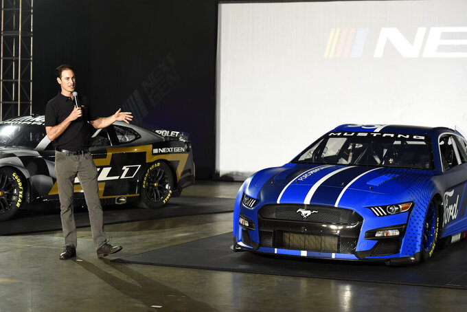 Driver, Joey Lagano talks about the Next Gen Mustang Cup car that will be used starting in the 2022 season during the NASCAR media event in Charlotte, N.C., Wednesday, May 5, 2021. (AP Photo/Mike McCarn)