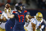 CORRECTS MONTH TO SEPTEMBER INSTEAD OF OCTOBER - Arizona quarterback Grant Gunnell (17) throws against UCLA in the first half of an NCAA college football game, Saturday, Sept. 28, 2019, in Tucson, Ariz. (AP Photo/Rick Scuteri)