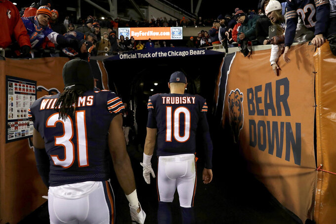 Chicago Bears quarterback Mitchell Trubisky (10) walks to the locker room after an NFL wild-card playoff football game against the Philadelphia Eagles Sunday, Jan. 6, 2019, in Chicago. The Eagles won 16-15. (AP Photo/Nam Y. Huh)