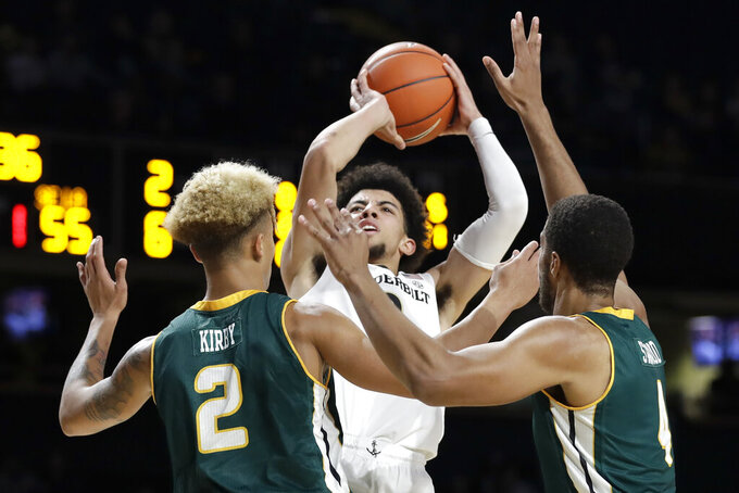 Vanderbilt guard Scotty Pippen Jr., center, shoots over Southeastern Louisiana's Isiah Kirby (2) and Maxwell Starwood (4) in the second half of an NCAA college basketball game Monday, Nov. 25, 2019, in Nashville, Tenn. (AP Photo/Mark Humphrey)