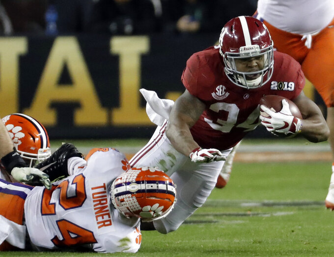 Alabama's Damien Harris is stopped during the second half of the NCAA college football playoff championship game against Clemson, Monday, Jan. 7, 2019, in Santa Clara, Calif. (AP Photo/Chris Carlson)
