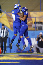 San Jose State wide receiver Isaiah Hamilton, right, celebrates with Tre Walker (10) after catching a pass for a touchdown against Boise State during the first half of an NCAA college football game, in San Jose, Calif., Saturday, Nov. 2, 2019. (AP Photo/Tony Avelar)