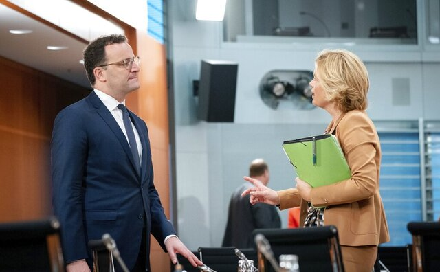 Jens Spahn, Federal Minister of Health, and Julia Kloeckner, Federal Minister of Food and Agriculture, take part in the meeting of the Federal Cabinet at the Federal Chancellery in Berlin, Germany, Wednesday, Sept. 23, 2020. (Kay Nietfeld/dpa via AP)