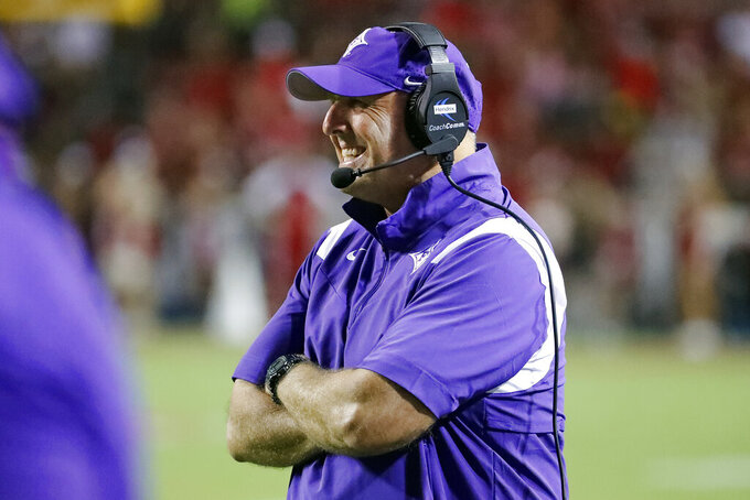 Furman head coach Clay Hendrix watches his team from the sidelines during the first half of an NCAA college football game against North Carolina State in Raleigh, N.C., Saturday, Sept. 18, 2021. (AP Photo/Karl B DeBlaker)