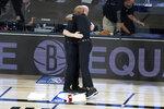 Orlando Magic head coach Steve Clifford, left, and Brooklyn Nets head coach Jacque Vaughn hug before the start of an NBA basketball game Friday, July 31, 2020, in Lake Buena Vista, Fla. (AP Photo/Ashley Landis, Pool)