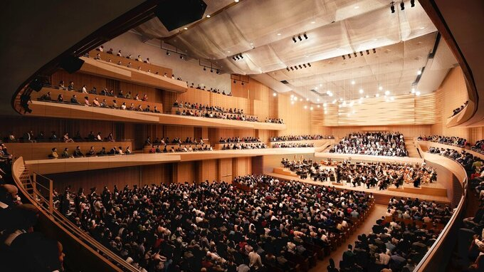 This artist rendering released by the New York Philharmonic shows the interior of David Geffen Hall in New York. The New York Philharmonic and Lincoln Center for the Performing Arts are accelerating the reconstruction of Geffen Hall because of the novel coronavirus pandemic and plan to reopen the auditorium in fall of 2022, about 1 1/2 years ahead of the original schedule. (Diamond Schmitt Architects/New York Philharmonic via AP)