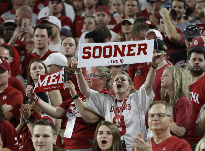 Oklahoma fans cheer their team, during the first half of the Orange Bowl NCAA college football game against Alabama, Saturday, Dec. 29, 2018, in Miami Gardens, Fla. (AP Photo/Lynne Sladky)