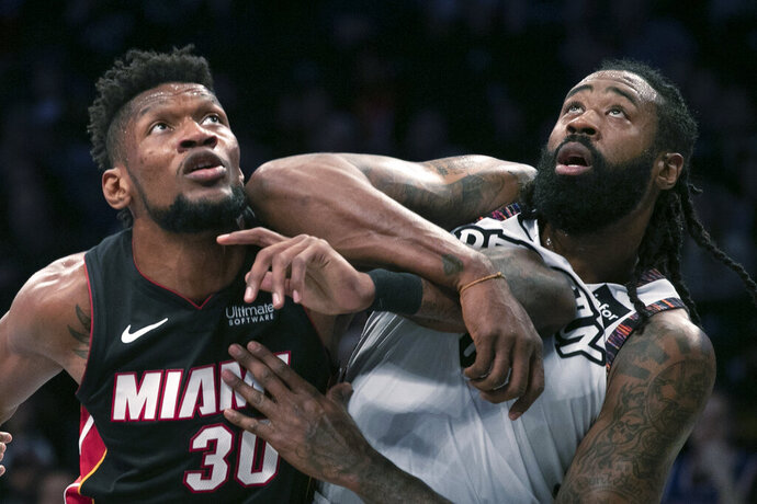 Miami Heat forward Chris Silva (30) catches an elbow from Brooklyn Nets center DeAndre Jordan (6) in the first half of a basketball game, Sunday, Dec. 1, 2019 in New York. (AP Photo/Mark Lennihan)