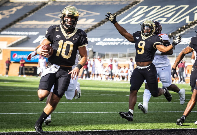 Wake Forest quarterback Sam Hartman (10) scores a touchdown during an NCAA college football game against Virginia Tech on Saturday, Oct. 24, 2020 at Truist Field in Winston-Salem, N.C. (Andrew Dye/The Winston-Salem Journal via AP)