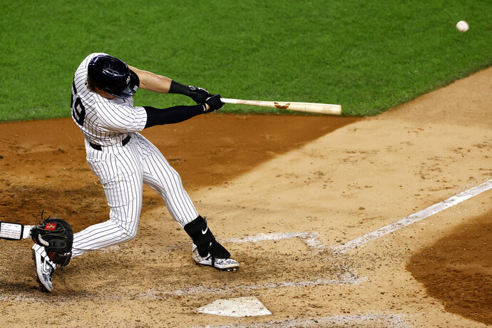 New York Yankees' Luke Voit hits a three-run home run during the fifth inning of the second baseball game of the team's doubleheader against the Baltimore Orioles, Friday, Sept. 11, 2020, in New York. (AP Photo/Adam Hunger)