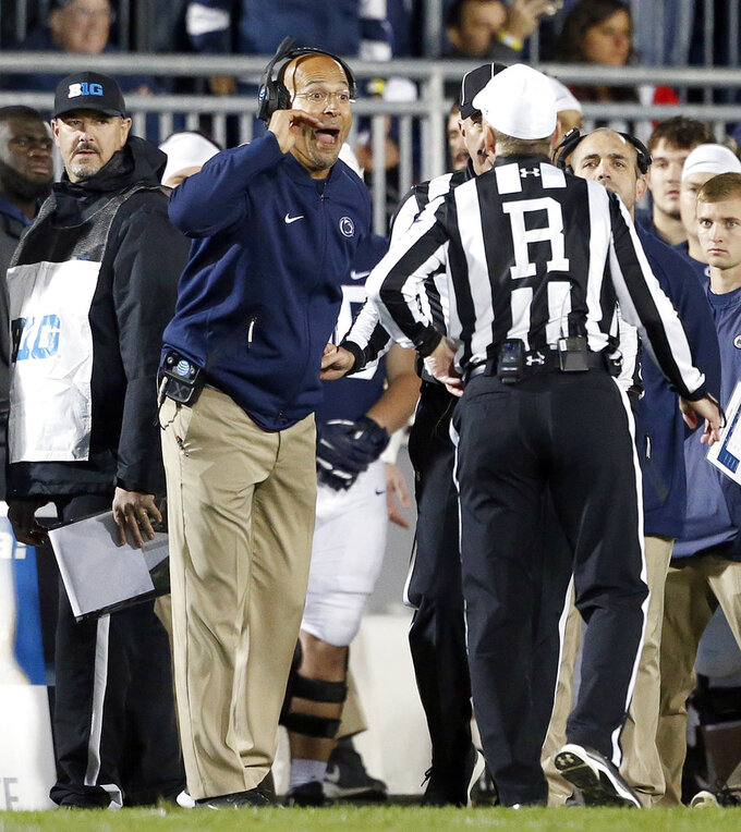 Penn State head coach James Franklin, front left, argues a call with the referees as the team takes on Michigan State during the second half of an NCAA college football game in State College, Pa., Saturday, Oct. 13, 2018. (AP Photo/Chris Knight)