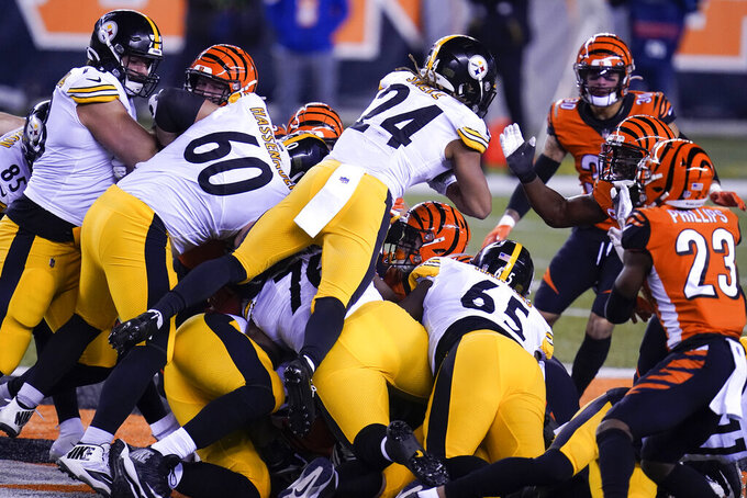 Pittsburgh Steelers' Benny Snell (24) dives for a first down on a fourth-down play during the first half of an NFL football game against the Cincinnati Bengals, Monday, Dec. 21, 2020, in Cincinnati. (AP Photo/Michael Conroy)