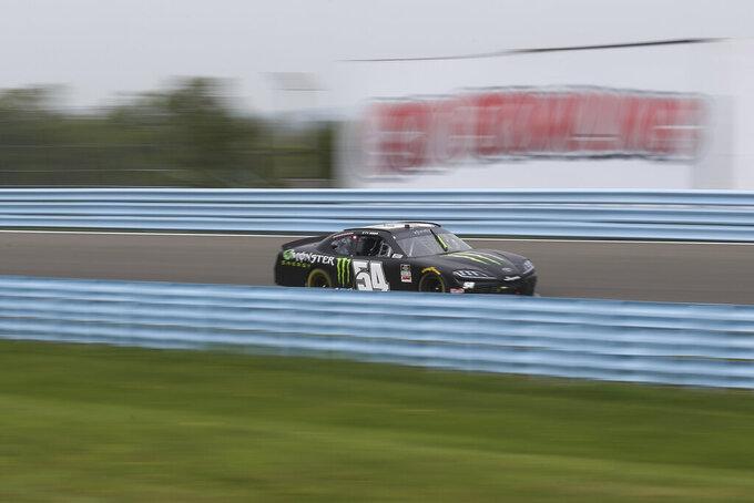 Ty Gibbs (54) drives through the esses during lap 31 of a NASCAR Xfinity Series auto race at Watkins Glen International in Watkins Glen, N.Y., on Saturday, Aug. 7, 2021. (AP Photo/Joshua Bessex)