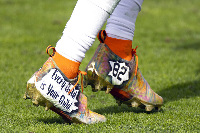 Custom cleats worn by Cleveland Browns wide receiver Rashard Higgins (82) are shown during an NFL football game against the Tennessee Titans, Sunday, Dec. 6, 2020, in Nashville, Tenn. Five years ago, about 500 players participated in the inaugural campaign, marking the first time players could wear custom cleats during games without facing fines. This year, more than 1,000 players took part, wearing their cleats during Week 13 games to raise awareness and funds for various causes. (AP Photo/Brett Carlsen)