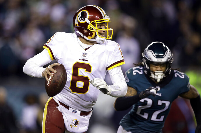 FILE - In this Monday, Dec. 3, 2018, file photo, Washington Redskins quarterback Mark Sanchez (6) looks to pass during an NFL football game against the Philadelphia Eagles,, Philadelphia. The 32-year-old Sanchez hasn't won a regular-season start in almost exactly four years.  He'll be on the field Sunday when Washington (6-6) hosts the New York Giants (4-8). (AP Photo/Matt Rourke, File)