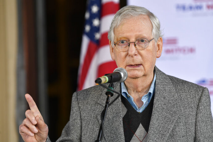 Senate Majority Leader Mitch McConnell, R-Ky., speaks to a gathering of supporters in Lawrenceburg, Ky., Wednesday, Oct. 28, 2020. (AP Photo/Timothy D. Easley)