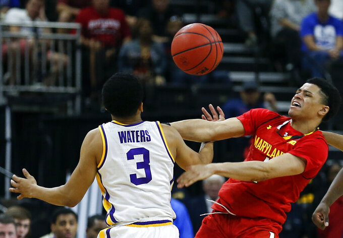 LSU's Tremont Waters (3) and Maryland's Anthony Cowan Jr. go after a loose ball during the first half of a second-round game in the NCAA men's college basketball tournament in Jacksonville, Fla., Saturday, March 23, 2019. (AP Photo/Stephen B. Morton)