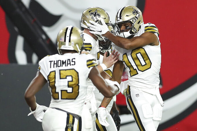 New Orleans Saints wide receiver Tre'Quan Smith (10) celebrates with teammates, including wide receiver wide receiver Michael Thomas (13) after scoring against the Tampa Bay Buccaneers during the first half of an NFL football game Sunday, Nov. 8, 2020, in Tampa, Fla. (AP Photo/Mark LoMoglio)