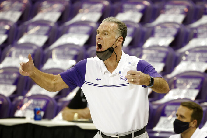 TCU head coach Jamie Dixon directs his team against Texas during the first half of an NCAA college basketball game in Fort Worth, Texas, Sunday, March 7, 2021. (AP Photo/Michael Ainsworth)