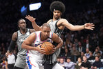Philadelphia 76ers center Al Horford, front, drives to the basket against Brooklyn Nets center Jarrett Allen, top, during the first half of an NBA basketball game, Monday, Jan. 20, 2020, in New York. (AP Photo/Mary Altaffer)