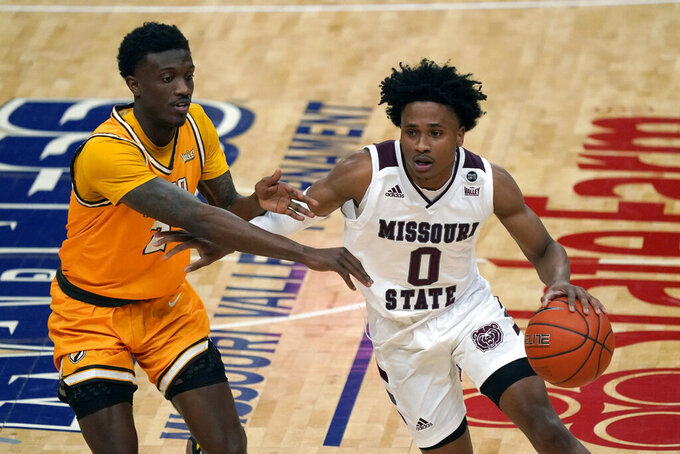 Missouri State's Demarcus Sharp (0) dribbles around Valparaiso's Zion Morgan (2) during the first half of an NCAA college basketball game in the quarterfinal round of the Missouri Valley Conference men's tournament Friday, March 5, 2021, in St. Louis. (AP Photo/Jeff Roberson)