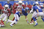 New York Giants' Saquon Barkley, center, runs the ball during the first half of an NFL football game against the Arizona Cardinals, Sunday, Oct. 20, 2019, in East Rutherford, N.J. (AP Photo/Bill Kostroun)