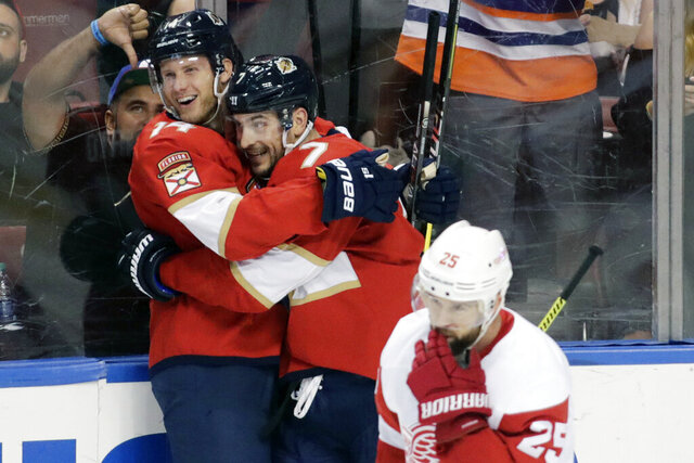 Florida Panthers' Dominic Toninato, left, celebrates with teammate Colton Sceviour, right, after scoring a goal during the second period of an NHL hockey game the against the Detroit Red Wings, Saturday, Dec. 28, 2019, in Sunrise, Fla. (AP Photo/Luis M. Alvarez)