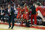 FILE - In this Dec. 10, 2014, file photo, Incarnate Word coach Ken Burmeister, second left, and players on the bench celebrate after Incarnate Word's Kyle Hittle, right, hit the go-ahead basket for a 74-73 win over Nebraska in an NCAA college basketball game in Lincoln, Neb. Burmeister, a college basketball coach for 21 seasons who took Texas-San Antonio to the NCAA Tournament and later guided Loyola of Chicago, died Tuesday, May 19, 2020. He was 72. Loyola said Burmeister died following a bout with cancer. (AP Photo/Nati Harnik, File)