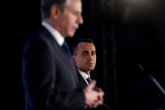 Secretary of State Antony Blinken, left, accompanied by Italy's Foreign Minister Luigi Di Maio, right, speaks during a news conference at Fiera Roma in Rome, Monday, June 28, 2021. Blinken is on a week long trip in Europe traveling to Germany, France and Italy. (AP Photo/Andrew Harnik, Pool)
