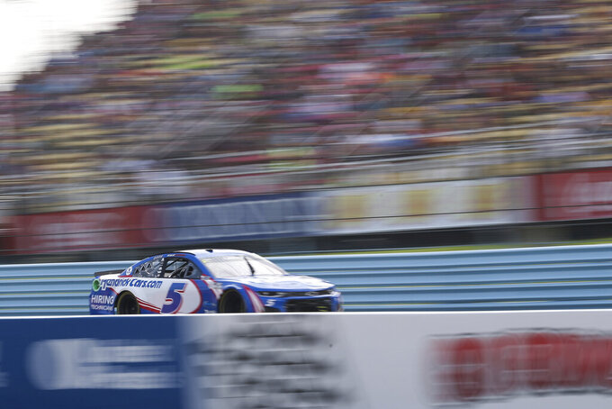 Kyle Larson drives by the grandstand near the finish line during a NASCAR Cup Series auto race in Watkins Glen, N.Y., on Sunday, Aug. 8, 2021. (AP Photo/Joshua Bessex)