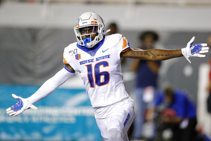 Boise State wide receiver John Hightower celebrates after scoring a touchdown against UNLV during the first half of an NCAA college football game Saturday, Oct. 5, 2019, in Las Vegas. (AP Photo/John Locher)