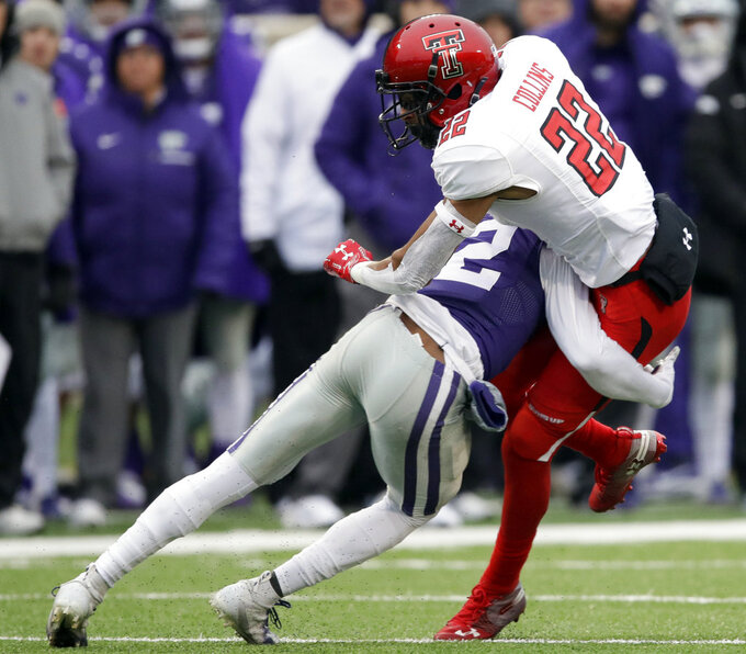 Texas Tech wide receiver Seth Collins (22) is tackled by Kansas State defensive back AJ Parker, left, during the first half of an NCAA college football game in Manhattan, Kan., Saturday, Nov. 17, 2018. (AP Photo/Orlin Wagner)
