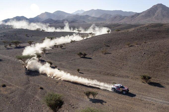 Driver Carlos Sainz, of Spain, and co-driver Lucas Cruz, of Spain, race their Mini during stage two of the Dakar Rally, between Al Wajh and Neom, Saudi Arabia, Monday, Jan. 6, 2020. (AP Photo/Bernat Armangue)