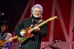 FILE - Marty Stuart performs during Marty Stuart's 16th Annual Late Night Jam at the Ryman Auditorium on June 7, 2017 in Nashville, Tenn.  Stuart, along with Dean Dillon and Hank Williams Jr., will be inducted into the Country Music Hall of Fame. (Photo by Amy Harris/Invision/AP, File)